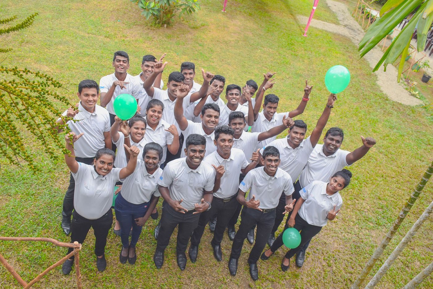 Group of smiling students from our youth employment progamme in Sri Lanka, in partnership with TUI Care Foundation