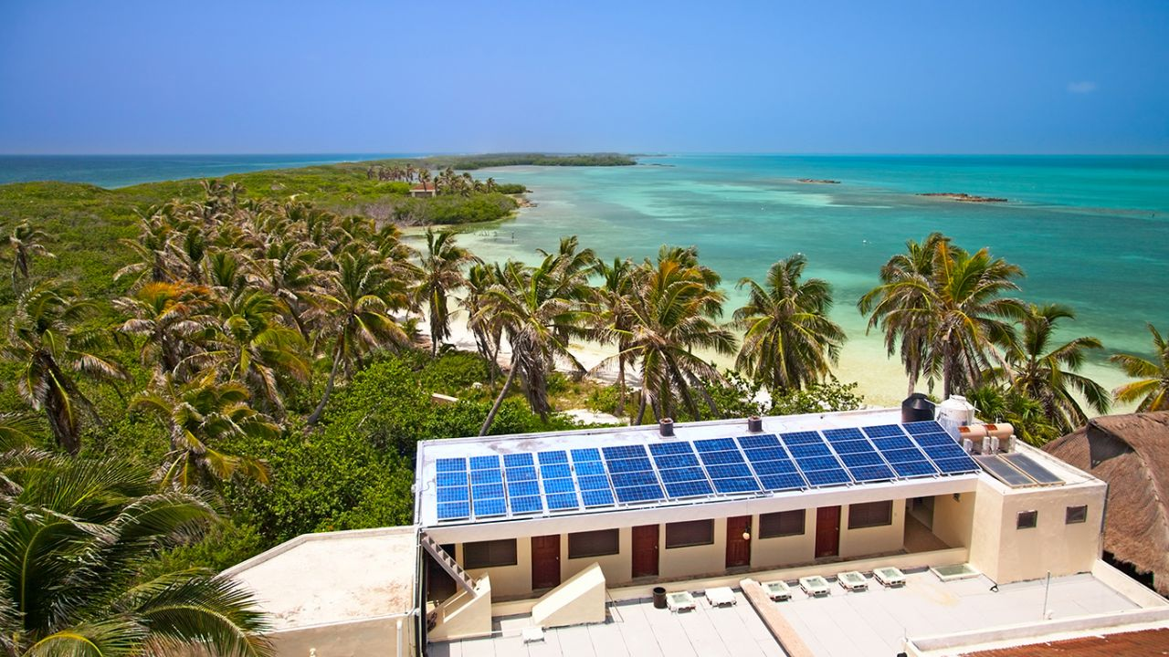 Sustainable hotel on a tropical beach with solar panels