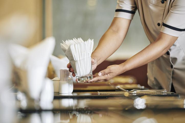 Waitress setting the table
