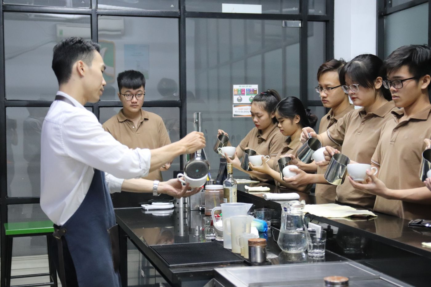 Group of vietnamese students learning to make a coffee