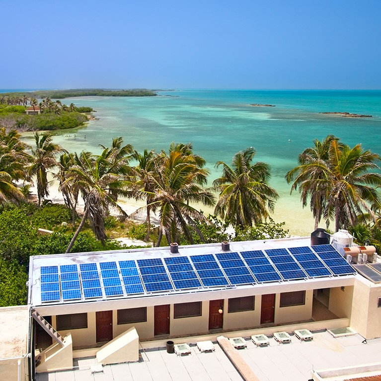 Hotel on a beach with solar panels
