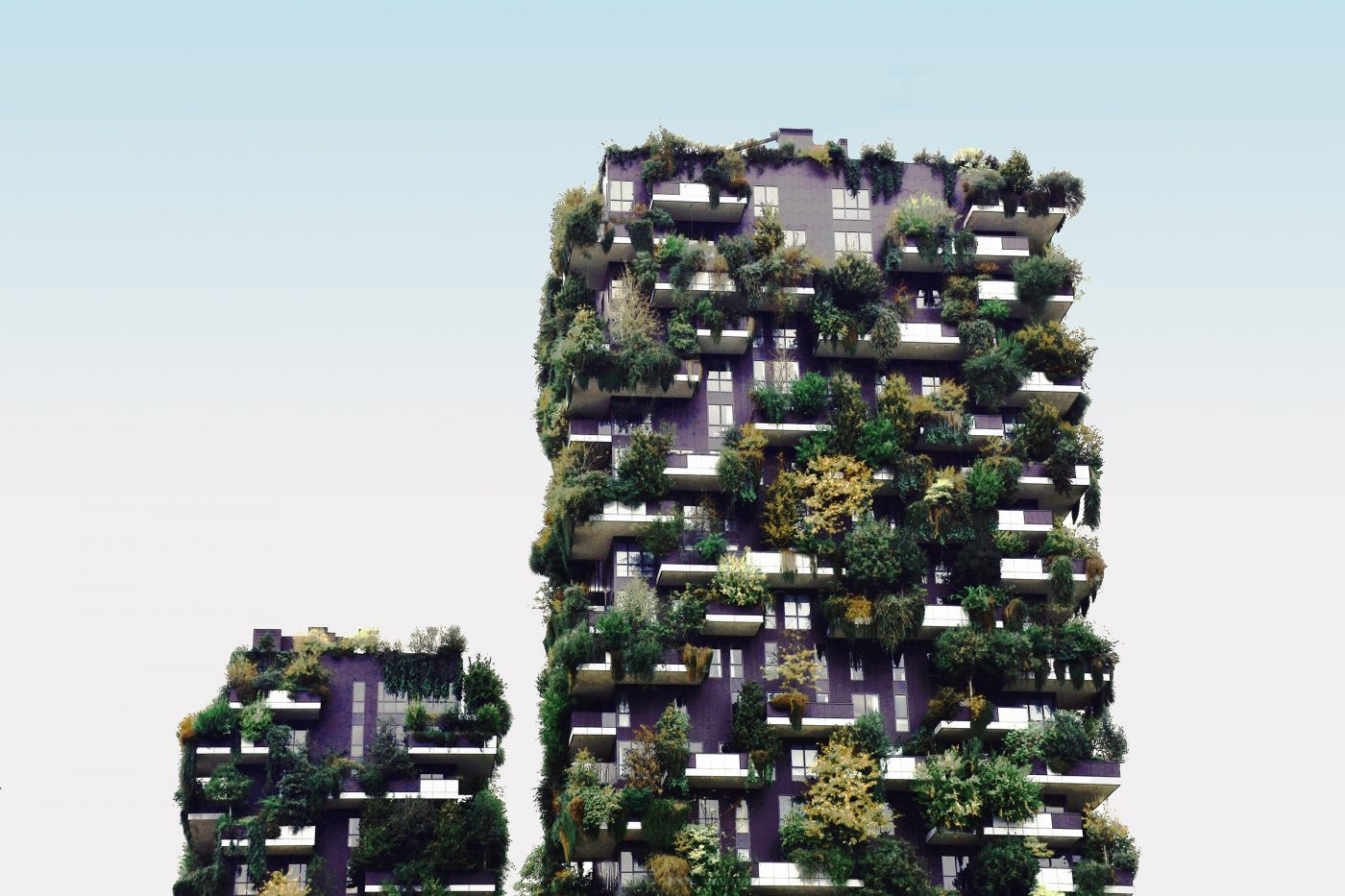 A sustainable hotel with plants on the balconies.